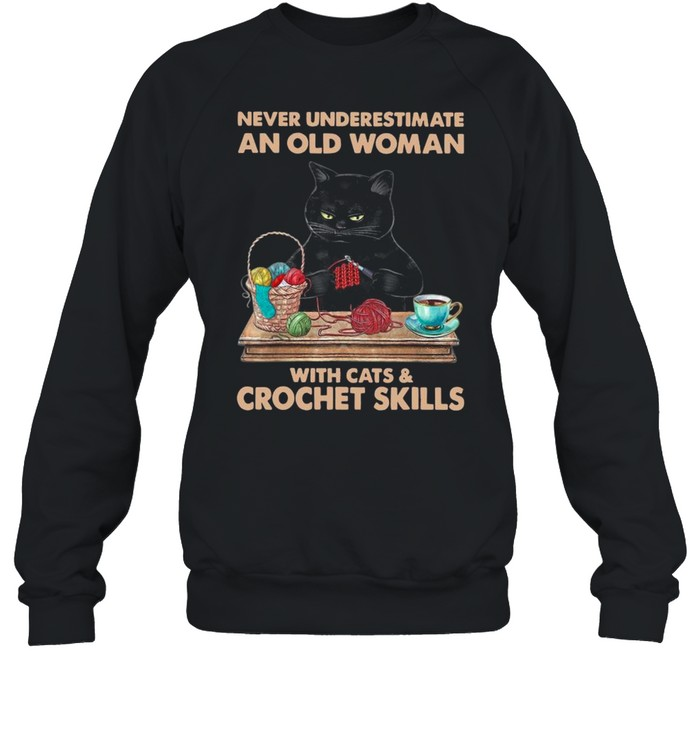 black cat never underestimate an old woman with cats and crochet skills shirt unisex sweatshirt